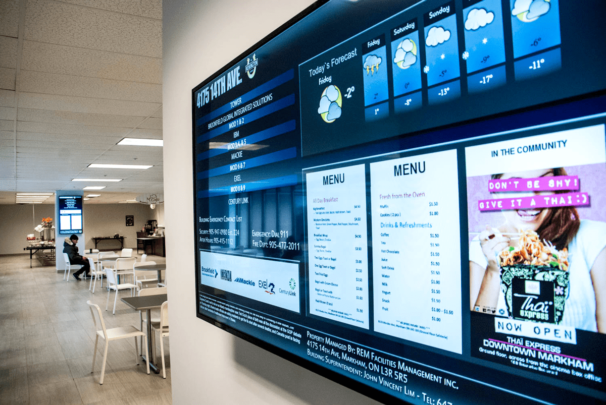 large digital signage screen mounted on wall with digital directory